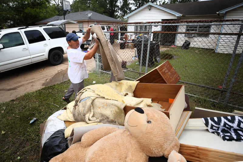 The Garcia family cleans out their home and garage in East Houston a week after Hurricane Harvey brought major flooding.