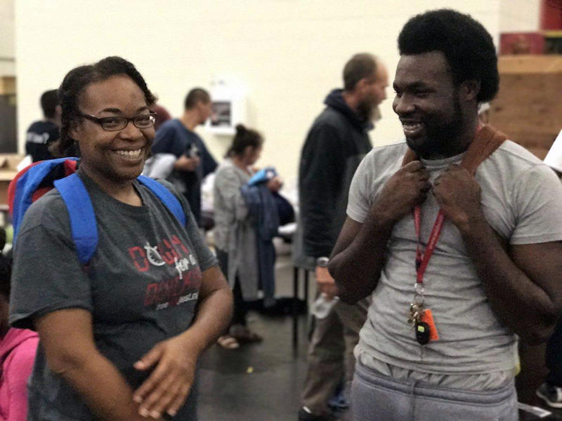 Demetrius Washington and his mother, Ramona, learn that his grandmother is safe Tuesday, Aug. 29 at the George R. Brown Convention Center in Houston.