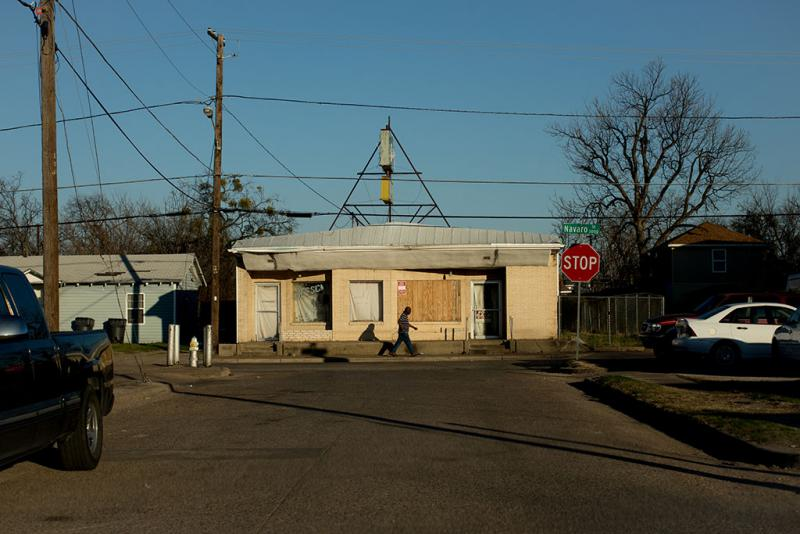 A man walks along Navaro Street in West Dallas.
