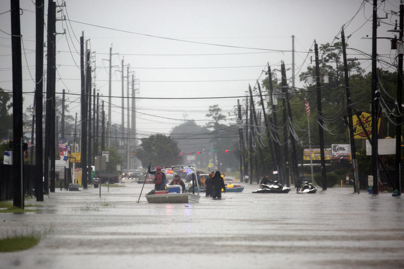 Two rescue boats from the Georgetown Sheriff's Dept. help evacuate residents from their homes in East Houston on Aug. 29, 2017 as Hurricane Harvey brought record floods to the area.