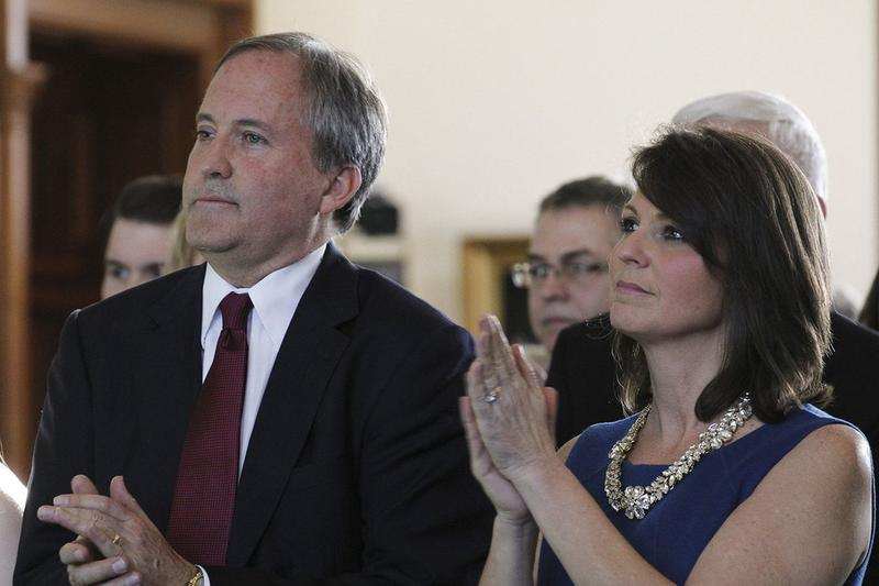 Ken Paxton and wife Angela at his swearing in as attorney general at the Texas Senate chambers in Austin on Jan. 15, 2015.