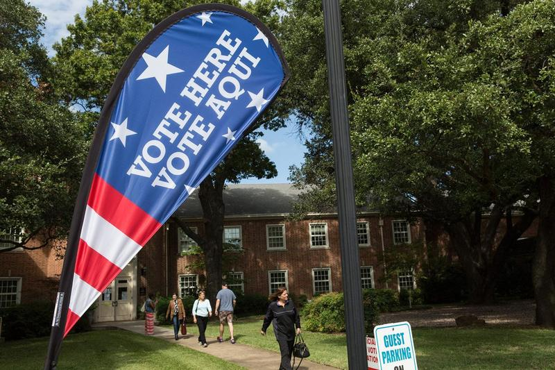 Voters proceed in and out of the University Park Methodist Church in Dallas for the first day of early voting on Oct. 24, 2016.