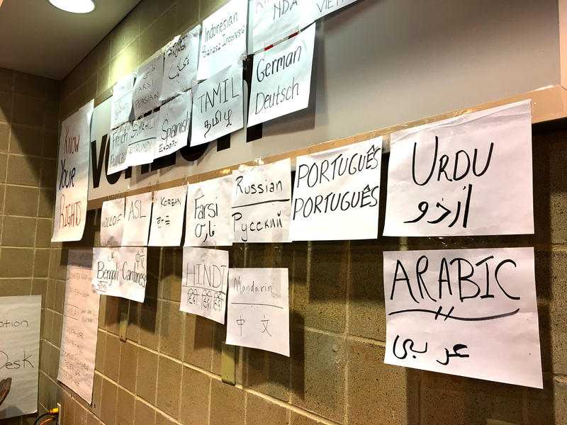 Houston Immigration Legal Services Collaborative is set up at the NRG Center, with several posters that hope to welcome undocumented immigrants and encourage them to get help.