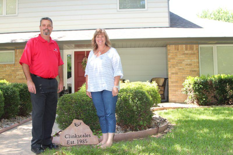 Steve and DeEdra Clinkscales in front of their home in Cleburne.