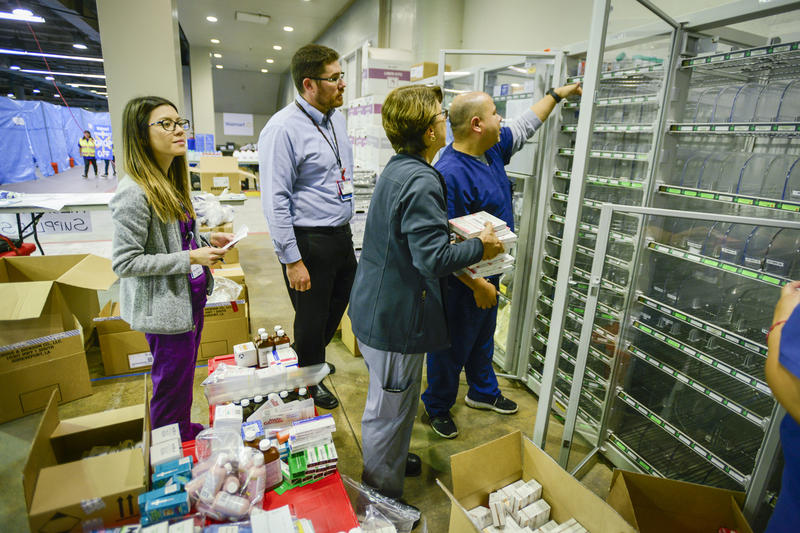 Children's Health staff setting up supplies at the shelter inside the Dallas convention center.
