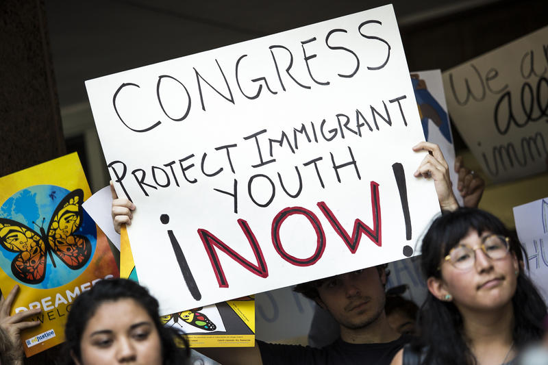 Signs at an Austin rally in support of the Deferred Action for Childhood Arrivals (DACA) policy led by DACA-recipient students, teachers and other education and community members.