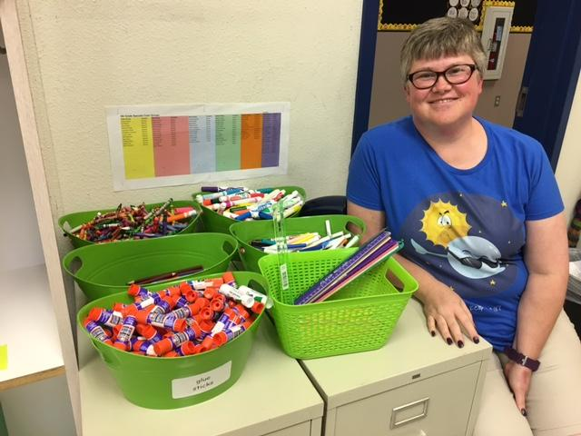 "Denton ISD teacher Willa Kemper sits in the ""share area"" of her classroom. She bought 300 gluesticks with her own money this summer, so students would have enough."