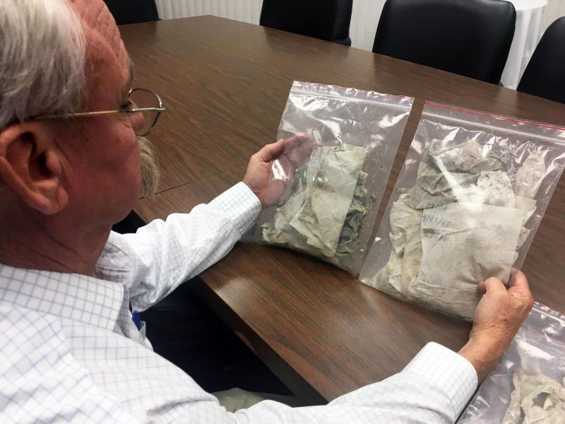 Bill Cyrus looks at used wet wipes removed from North Texas sewers, trying to figure out which brands are clogging the system.