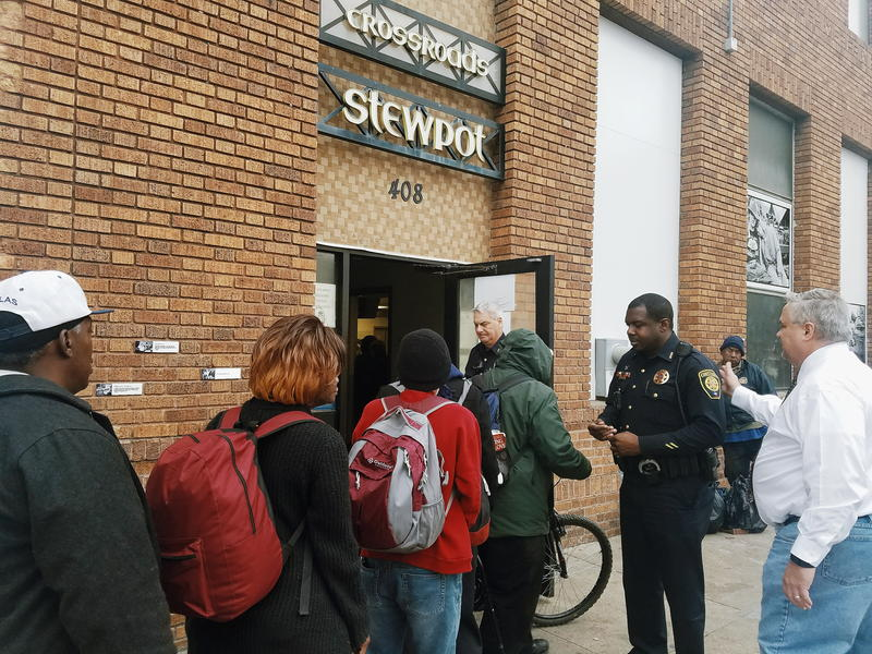 "People experiencing homelessness line outside The Stewpot in Dallas for ""community court"" to resolve tickets for minor offenses."