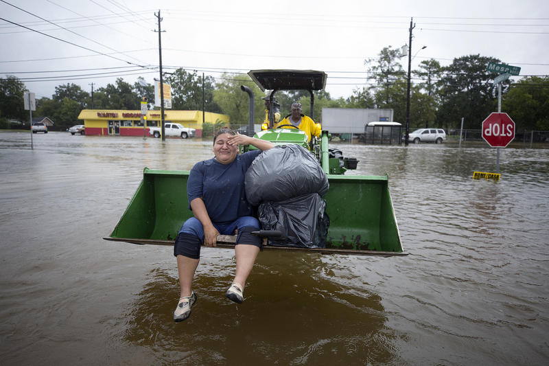 Christy Garcia was rescued from her Houston home by Mel Harris who used his John Deere tractor to pull hundreds of people out of their flooded homes after Hurricane Harvey hit in August 2017.