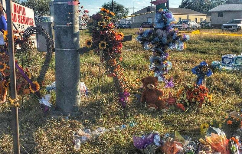 A roadside memorial off U.S. Highway 87 was erected in memory of the 26 killed in a church shooting in Sutherland Springs on Sunday.