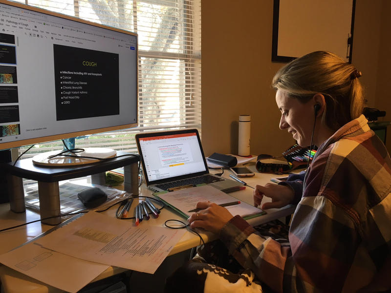 Kelly Johnson, a medical student at the Texas College of Osteopathic Medicine, studies for an exam at her home in Fort Worth, Texas, in November 2017.