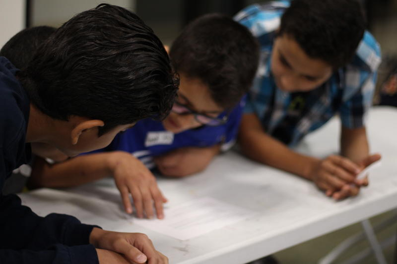 A group of Muslim boys go over a bullying scenario during an anti-bullying workshop in Plano.