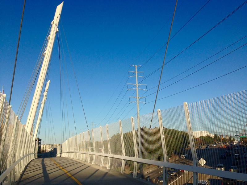 The Mockingbird Pedestrian Bridge runs from Mockingbird DART Station to the back of the Highland Dallas hotel.
