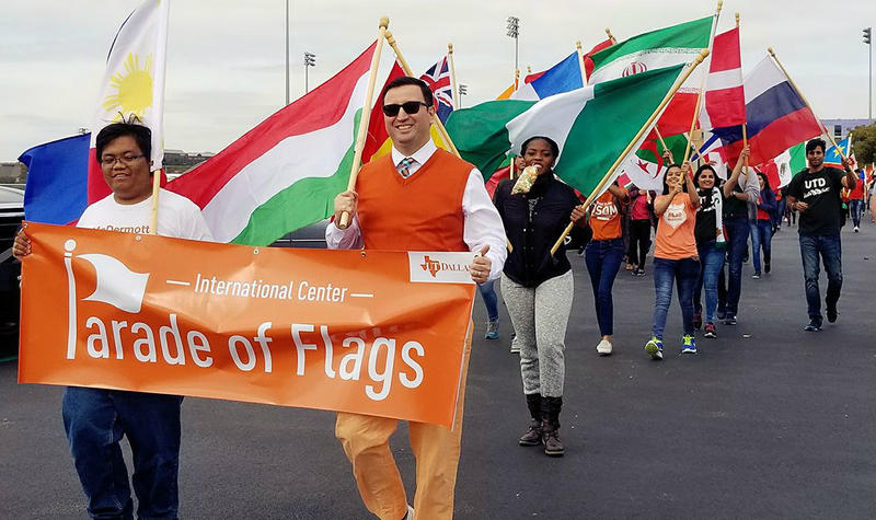 The annual Homecoming festivities at the University of Texas at Dallas include a Parade of Flags, representing the countries where students were born.