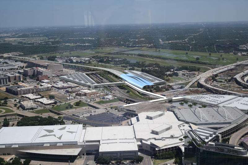 A view from downtown Dallas looking at the Kay Bailey Hutchinson Convention Center in the foreground and the bullet train station to the southeast of the Cedars neighborhood.