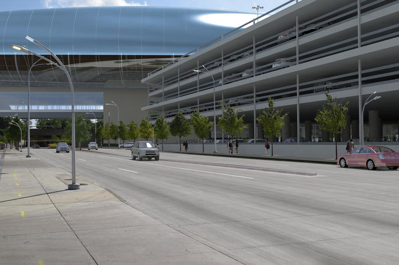 Rendering of the Dallas bullet train station from the street level. A parking structure is to the right with the main station platform above.