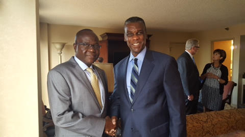 Zachary Thompson, right, with Liberian Ambassabor to the United States, Jeremiah C. Sulunteh, in a September 2015 photo from an event marking one year since Ebola made its way to Dallas.