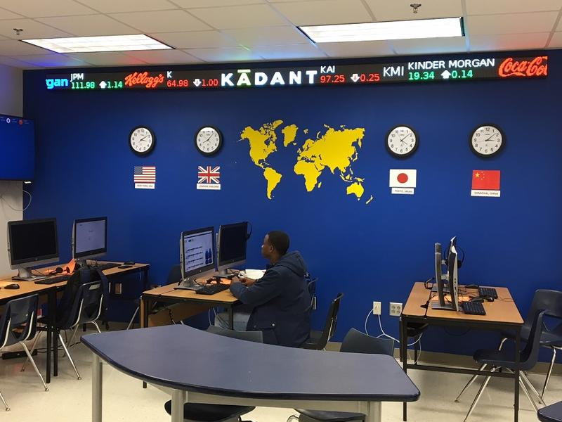 A student works under the stock ticker that runs in the Conrad High School finance lab.