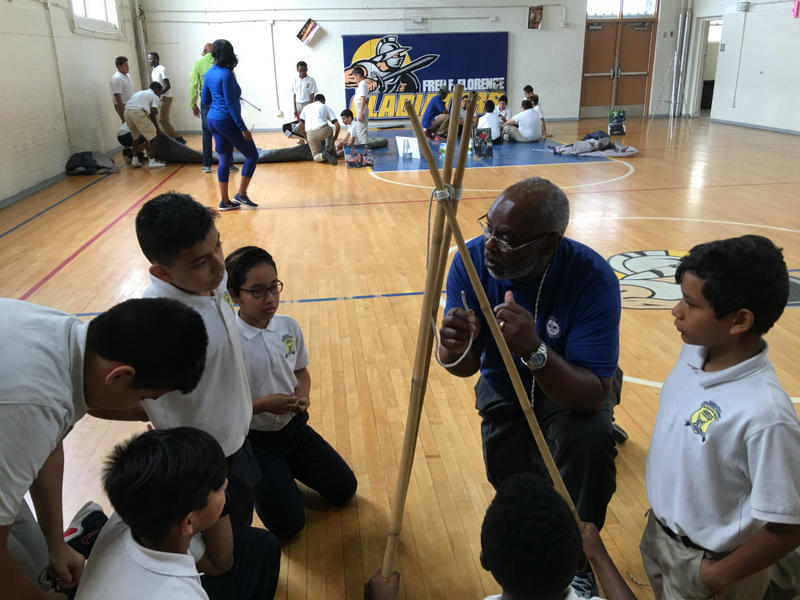 David Payne teaches Boy Scout techniques during gym class at Dallas' Young Men's Leadership Academy at Fred Florence Middle School.