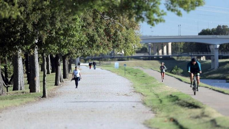 Walkers, runners and cyclist use the Trinity Trail near the Clear Fork development in Fort Worth in October 2017.