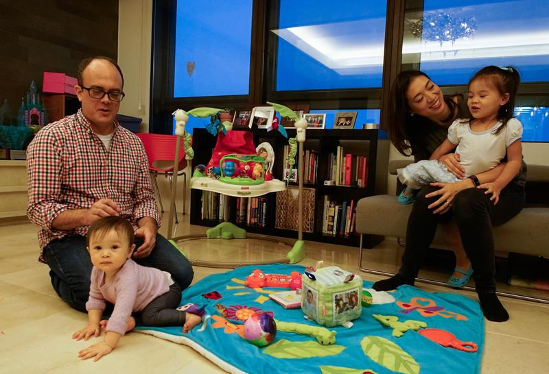 NPR correspondent Elise Hu and her husband, Los Angeles Times reporter Matt Stiles, wrangle two of their three daughters, 10-month-old Luna (left) and 2-year-old Isa.