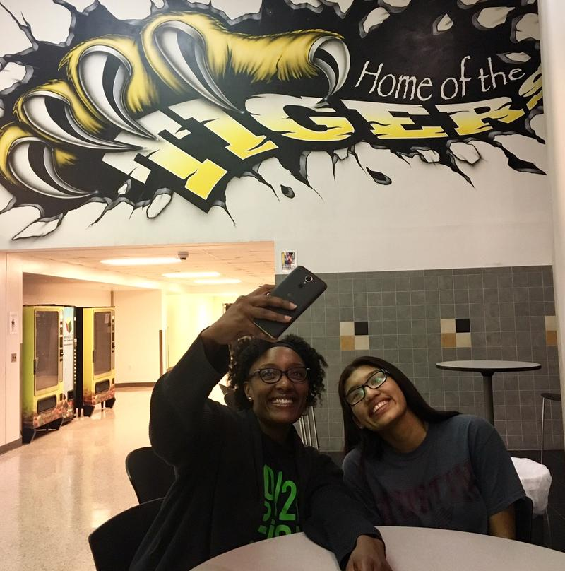 Shatara Lemons and her mentee, Nataly Gutierrez, take a selfie inside Irving High School. Most of their interactions are via an online portal that prepares students for college. The Big Brothers Big Sisters initiative is called Mentoring 2.0.