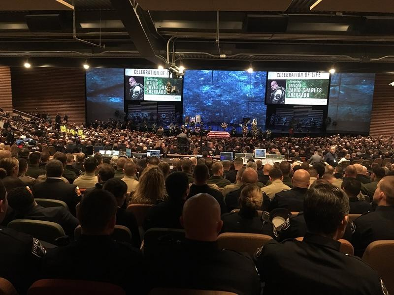 Richardson police officer David Sherrard is remembered Tuesday afternoon at Watermark Community Church in Dallas.