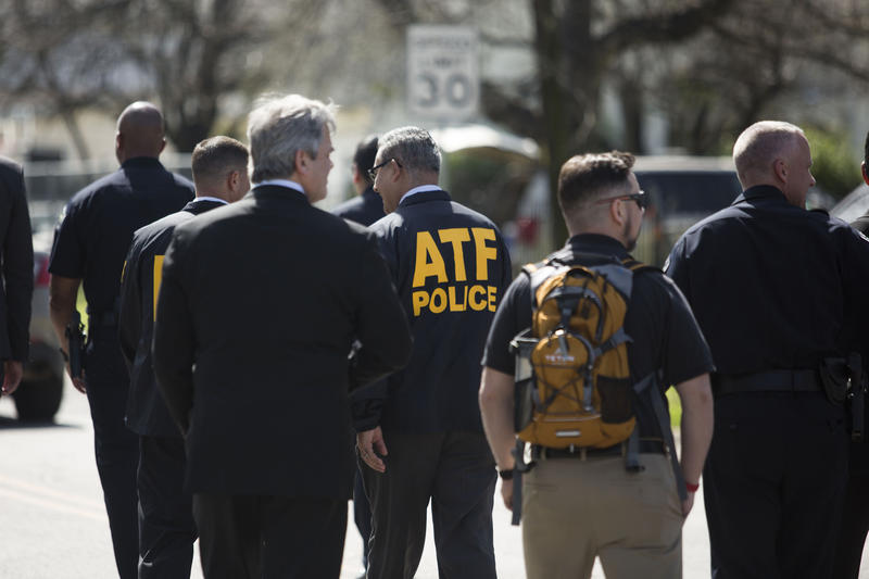 Members of local, state and federal law enforcement including the FBI, ATF and Department of Homeland Security hold a press conference near the scene of a third fatal package explosion in East Austin.