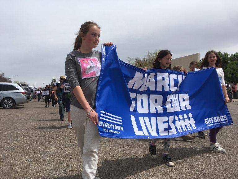 """Delia Jones (left) and her friend Louise Culbertson (far right) organized the """"March For Our Lives"""" event in Marfa on Saturday."""