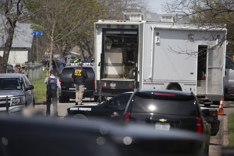 FBI, ATF, and other state and local law enforcement, including SWAT teams and a bomb robot, surround and investigate the address of 403 2nd Street, home of suspect Mark Anthony Conditt, in the town of Pflugerville, north of Austin.