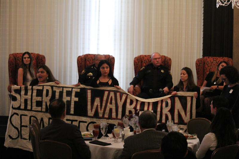 Members of United Fort Worth, an immigrant rights group, interrupted a forum at the Fort Worth Club on Tarrant County's partnership with ICE.