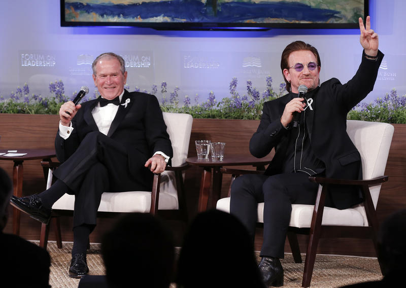 Former President George W. Bush and U2 frontman Bono talk to the crowd gathered at the George W. Bush Presidential Center Thursday night in Dallas.