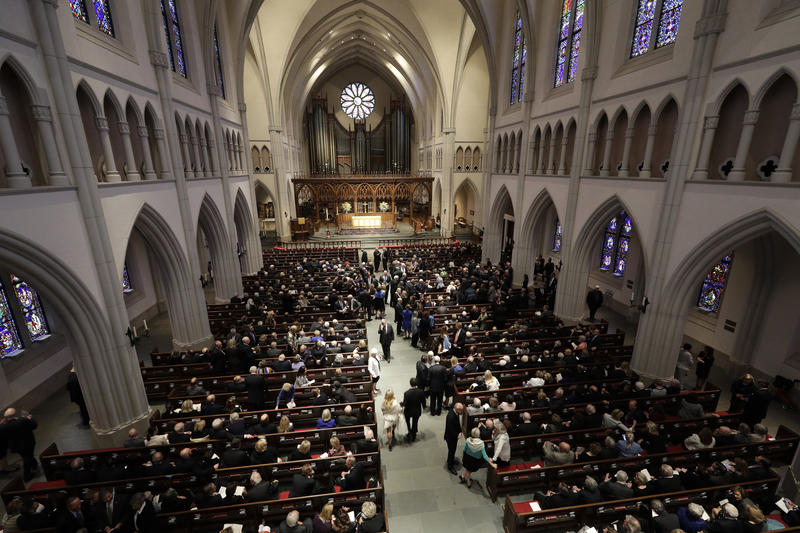 Attendees arrive at St. Martin's Episcopal Church for a funeral service for former first lady Barbara Bush, Saturday, April 21, 2018, in Houston.