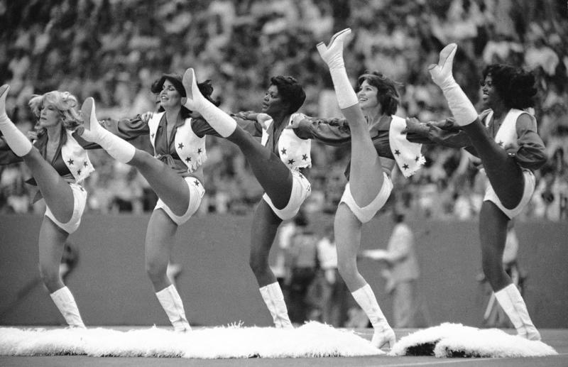 The Dallas Cowboys' cheerleaders perform a high-kicking routine at an NFL game in Miami, Fla., in Sept. 5, 1978.