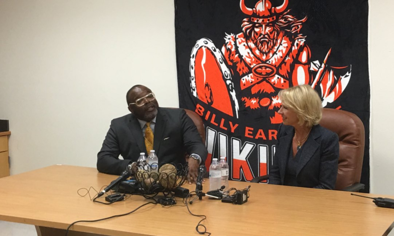 From left: Urban Specialists Bishop Omar Jahwar and Education Secretary Betsy DeVos.