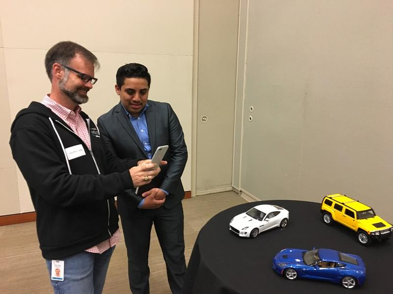 Geoffrey Dagley shows Daniel Uribe how the augmented reality program works at a student event at Capital One.