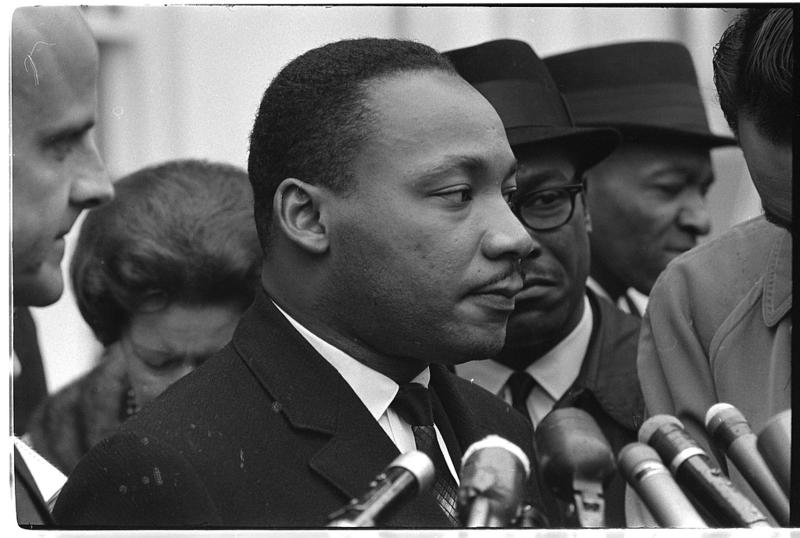 Dr. Martin Luther King, Jr. in 1963 after meeting with President Lyndon B. Johnson to discuss civil rights.