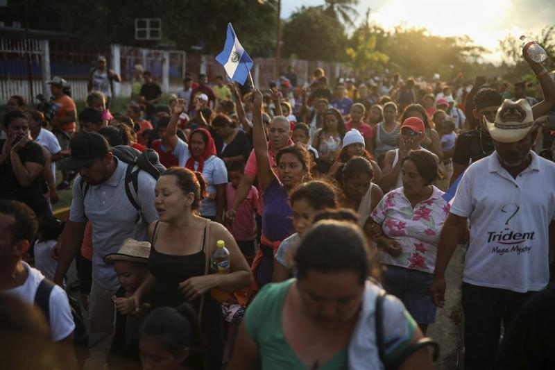 "Central American migrants traveling with the annual ""Stations of the Cross"" caravan march to call for migrants' rights and protest the policies of U.S. President Donald Trump and Honduran President Juan Orlando Hernandez, in Matias Romero, Mexico."
