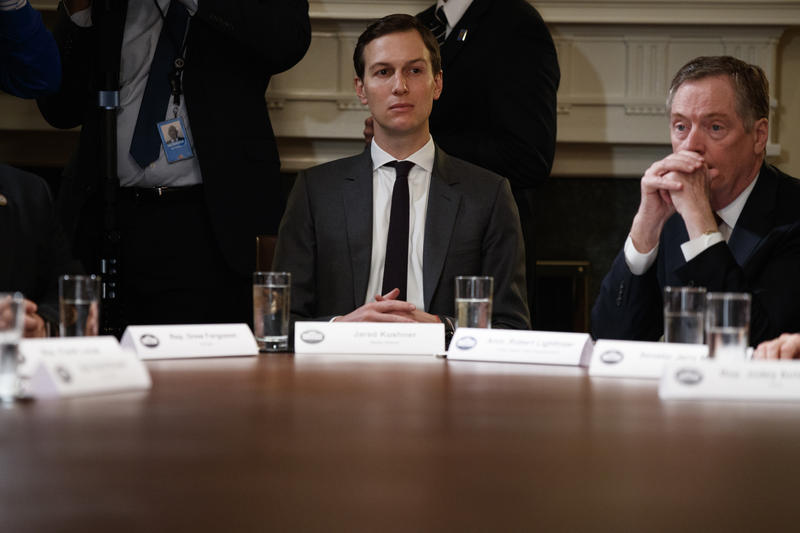 White House senior adviser Jared Kushner, left, and United States Trade Representative Robert Lighthizer listen as President Donald Trump speaks during a meeting with governors and lawmakers in the Cabinet Room of the White House on April 12, 2018.