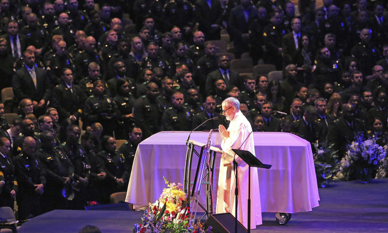 Scripture is read at the funeral for Dallas Police Officer Officer Rogelio Santander at Lake Pointe Church in Rockwall on Tuesday. Santander was shot and killed at a Home depot in Dallas last week.