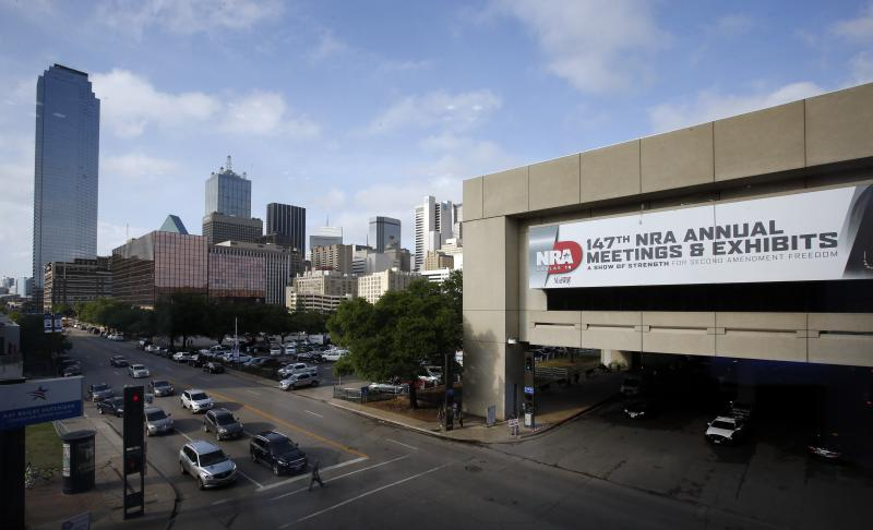 A view of the skyline and NRA convention signage is shown by the Kay Bailey Hutchison Convention Center in Dallas on Thursday.