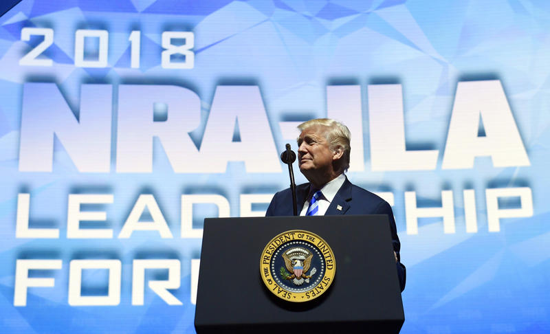 President Donald Trump speaks at the National Rifle Association's annual convention in Dallas on Friday. AP