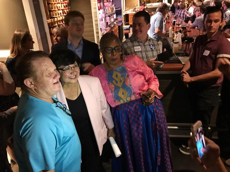 Democrat Lupe Valdez (second from left) takes a photo with supporters Tuesday night. Valdez is the first openly gay and Latina nominee for Texas governor in state history.