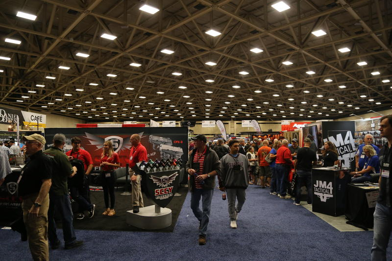 National Rifle Association members tour the exhibit hall at the Kay Bailey Hutchison Convention Center in Dallas on Friday.