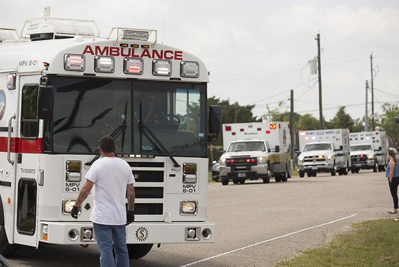 Amulances arrive at a middle school set up as a reunion point for parents and students in Santa Fe, Texas on Friday, March 18, 2018 after a gunman killed at least 10 people at Santa Fe High School.