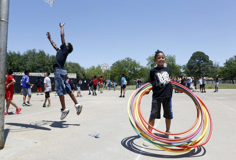 Second-grader Sunny Gomez spins all the hula hoops at once during Field Day on May 18, 2018 at Wimbish Elementary in Arlington.