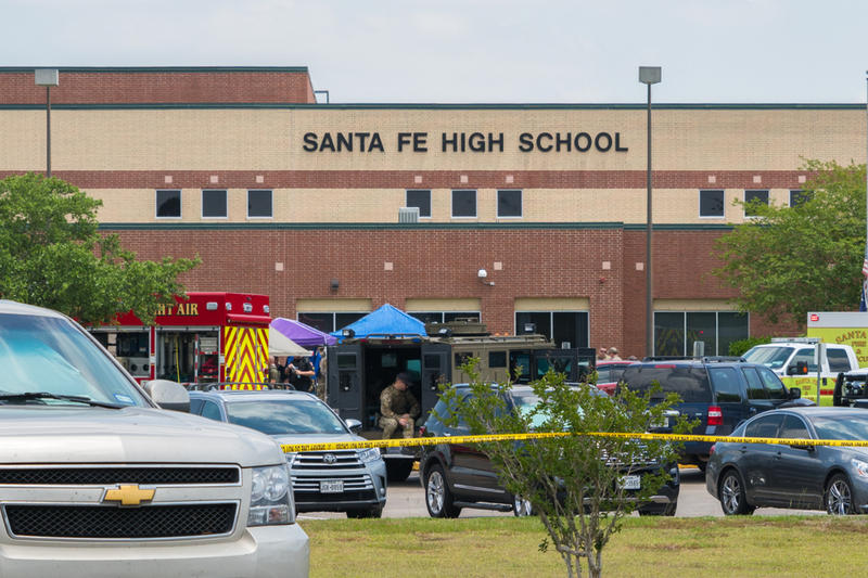 Multiple local, state and federal enforcement agencies process an active crime scene following a shooting at Santa Fe High School, southeast of Houston, on May 18.