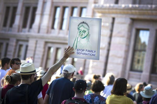 "Demonstrators rally against the Trump administration's ""zero tolerance"" policy of separating families crossing the Mexican border, at the Texas Capitol in Austin on June 14, 2018."