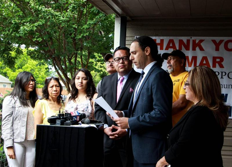 Khraish Khraish, third from right, announced his offer to sell several of his rental homes to tenants in West Dallas in May 2017.